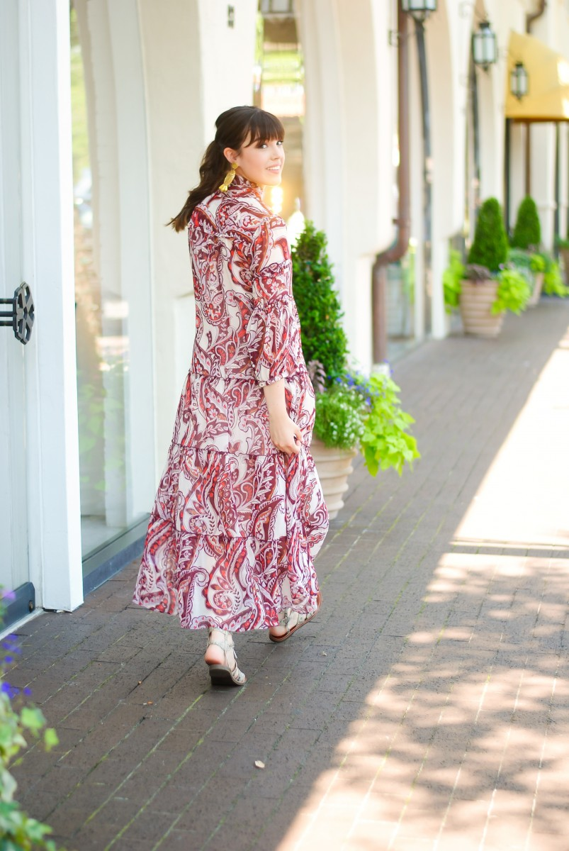 Style blogger Ashley Deatherage of Never Without wears a summer maxi dress with gladiator sandals | statement earrings, maxi dress outfit, maxi dress outfit summer, long sleeve maxi dress