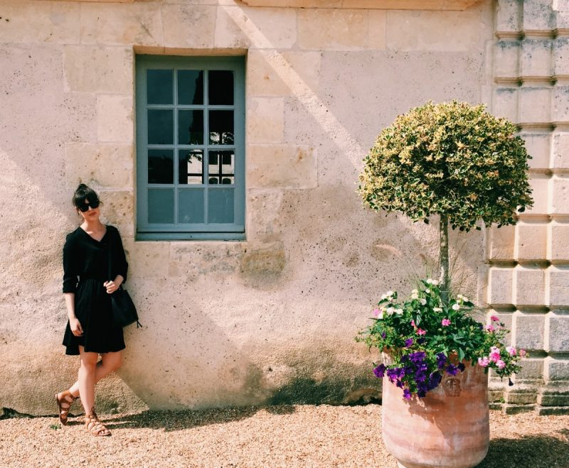 Sessun dress styled by top US fashion blog, Never Without Lipstick: image of a woman wearing a black Sessun dress, Dolce Vita Sandals, and a Lancaster bucket bag