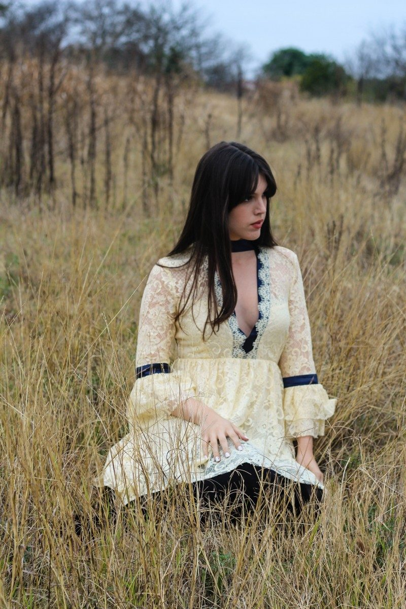 Style blogger Ashley Deatherage of Never Without Lipstick wears a lace dress and over the knee boots for a boho New Year's Eve outfit idea | new year's eve dress, new years eve outfit, new years eve dress boho, lace dress, boho dress outfit, over the knee boots outfit