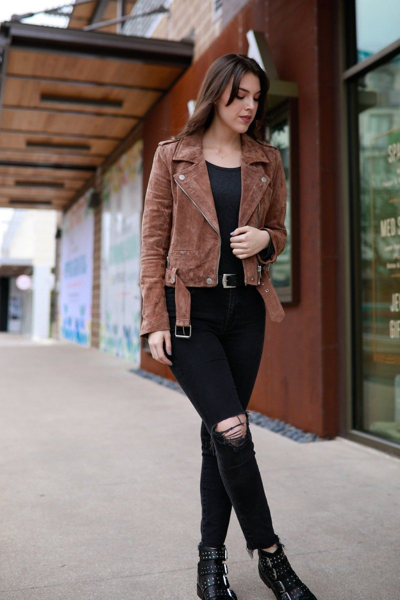 Style blogger Ashley Deatherage shares two ways to style a bodysuit outfit | bodysuit outfit, bodysuit fashion, fall fashion, fall outfit idea, outfit idea. casual outfit idea, bodysuit curvy, longsleeve bodysuit | Bodysuit Outfit featured by top US fashion blog, Never Without Lipstick: image of a woman wearing Madewell skinny black jeans, BLANKNYC suede Moto jacket, an American Eagle bodysuit, Neiman Marcus conch belt, and Marc Fisher Chelsea boots