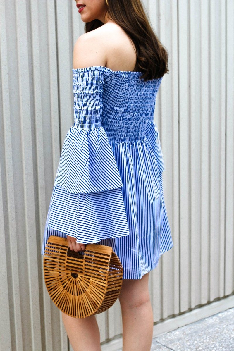 Summer Neutrals/Never Without Lipstick/striped dress, summer stripes, summer ootd, summer fashion 2017, summer outfits, tiered sleeves, goodnight macaroon, goodnight macaroon dress, cult gaia ark bag, cult gaia bag knockoff, cult gaia ark dupe, daniel wellington, classic petite bondi, mules, mule outfit, coral mules | Summer neutrals featured by top US fashion blog, Never Without Lipstick: image of a woman wearing a striped Goodnight Macaroon off the shoulder dress, Halogen coral sandals and a Cult Gaia bag