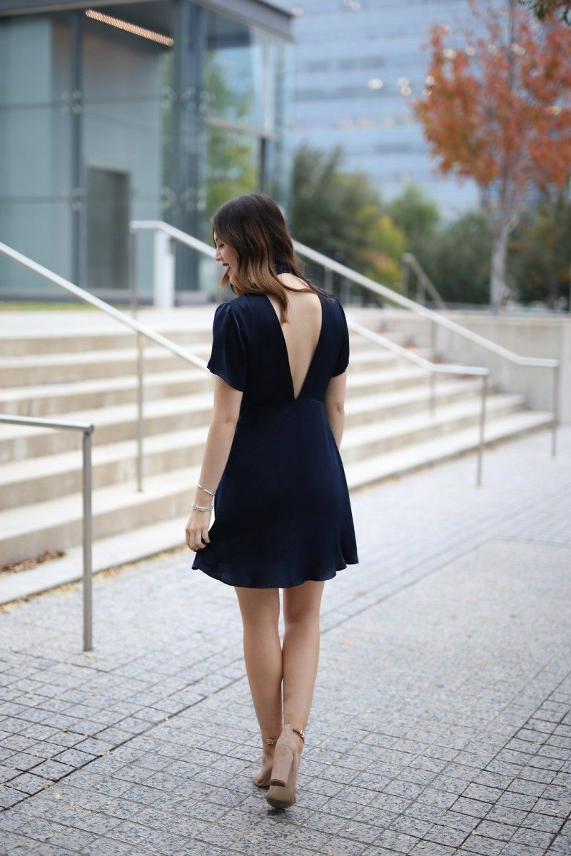Style blogger Ashley Lane of Never Without Lipstick wears a navy wrap dress with block heels | holiday party dresses, affordable holiday party dresses, holiday party dresses under 50, holiday party outfit, holiday party outfit idea, wrap dress, navy dress, holiday party dress christmas, holiday party dress work