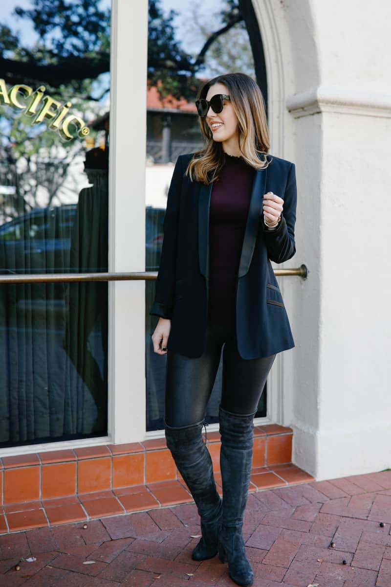 faux leather leggings outfit, how to style faux leather leggings, spanx faux leather leggings outfit, black spanx faux leather leggings, winter outfit idea, turtleneck outfit idea, black blazer outfit, stuart weitzman tieland boot, celine sunglasses  | Top Dallas fashion blog, Never Without Lipstick features a chic way to style SPANX faux leather leggings: image of a woman wearing SPANX faux leather leggings, FREE PEOPLE black turtleneck, a boyfriend blazer Stuart Weitzman over the knee boots.