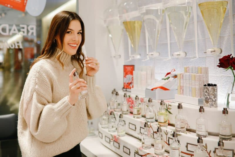 beauty gift ideas for her, christmas beauty gift ideas, gift guide for her, christmas gifts for mom, christmas gifts for sister  | The Best Beauty Gift Ideas featured by top Dallas beauty blog, Never Without Lipstick: image of a woman smelling a Fresh perfume