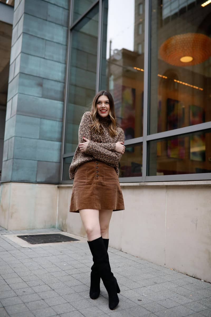 work to weekend clothing, winter outfit, casual winter outfit, corduroy skirt outfit, leopard sweater outfit, womens style | Work to weekend clothing for winter featured by top US fashion blog, Never Without Lipstick: image of a woman wearing a Who What Wear leopard turtleneck, Madewell corduroy mini skirt, Sam Edelman knee high boots