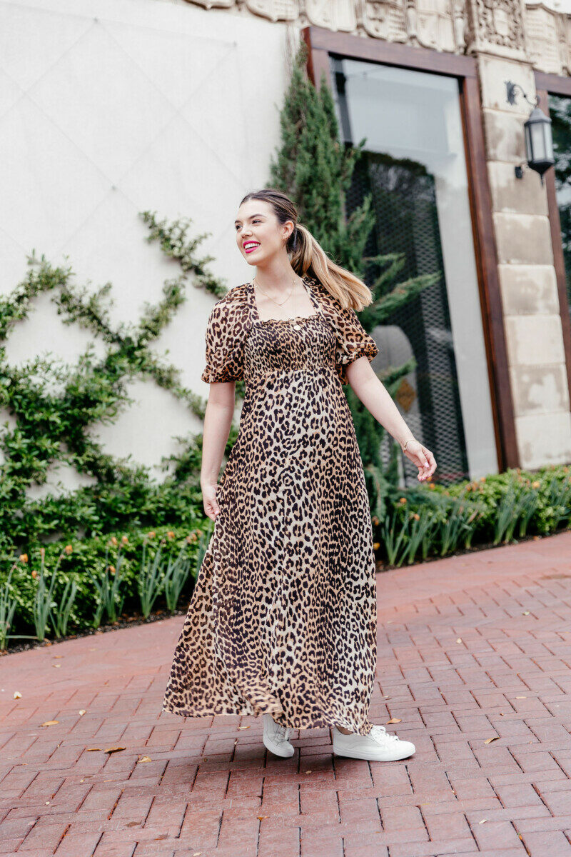 Cute Maxi Dresses featured by top US fashion blog Never Without Lipstick; Image of a woman wearing a leopard print maxi dress from ASOS.